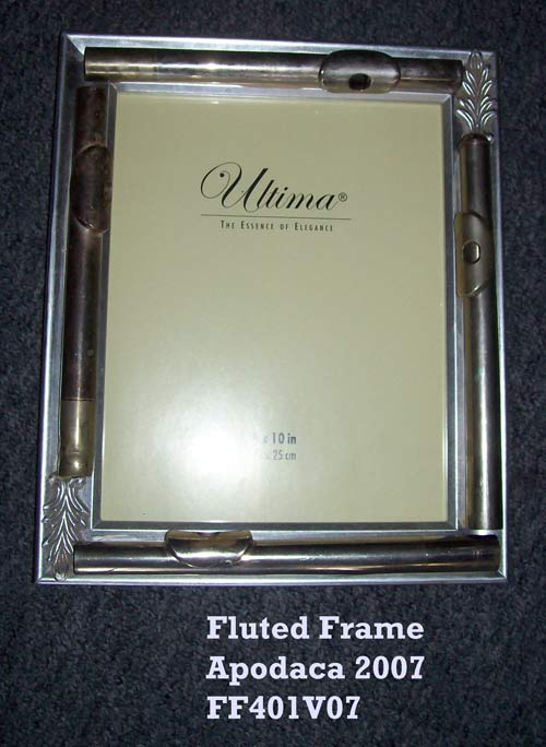 "Fluted Frame - This chrome painted frame can be used to enhance a picture of your favorite Flautist or concert photo. Four silver-plated flute head joints line each side of this frame. An 8"" x 10"" standard size photo would look great in this useable piece of artwork. Dimensions: 12.5"" x 11"" x1.5"" Price: CALL (949) 768-7110 or email admusic@cox.net"